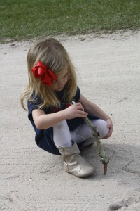 She had fun doodling in the sand